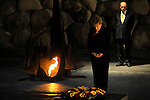 German Chancellor Angela Merkel lays a wreath at the Hall of Rememberence in the Yad Vashem holocaust memorial site, in Jerusalem, Israel, Monday March 17, 2008.<br /> <br /> Israeli PM Ehud Olmert is seen in background.<br /> <br /> (Photo by Ahikam Seri).