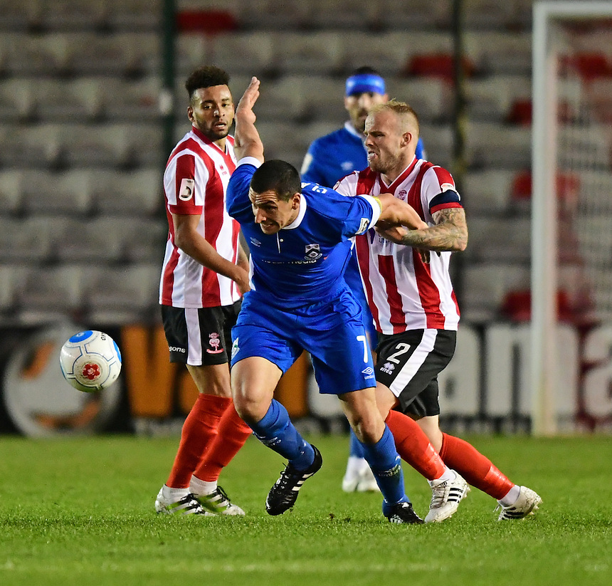 North Ferriby United's Danny Clarke vies for possession with Lincoln City's Bradley Wood<br /> <br /> Photographer Chris Vaughan/CameraSport<br /> <br /> Football - Vanarama National League - Lincoln City v North Ferriby United - Tuesday 9th August 2016 - Sincil Bank - Lincoln<br /> <br /> &copy; CameraSport - 43 Linden Ave. Countesthorpe. Leicester. England. LE8 5PG - Tel: +44 (0) 116 277 4147 - admin@camerasport.com - www.camerasport.com