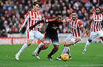 Anthony Martial of Manchester United is challenged by Philipp Wollscheid of Stoke City and Geoff Cameron of Stoke City<br /> - Barclays Premier League - Stoke City vs Manchester United - Britannia Stadium - Stoke on Trent - England - 26th December 2015 - Pic Robin Parker/Sportimage