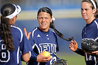 11 February 2012:  FIU's Mariah Dawson (23) receives instructions from Jessy Alfonso (8) as the University of Massachusetts Minutewomen defeated the FIU Golden Panthers, 3-1, as part of the COMBAT Classic Tournament at the FIU Softball Complex in Miami, Florida.