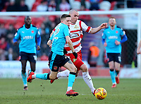 Ashley Hunter of Fleetwood Town and Luke McCullough of Doncaster Rovers challenging for the ball during the Sky Bet League 1 match between Doncaster Rovers and Fleetwood Town at the Keepmoat Stadium, Doncaster, England on 17 February 2018. Photo by Leila Coker / PRiME Media Images.