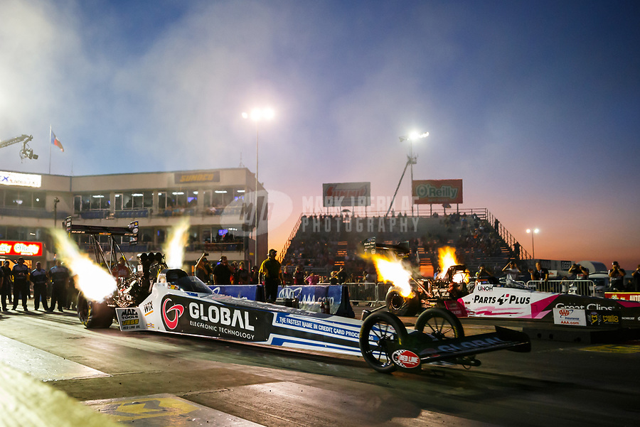 Oct 13, 2017; Ennis, TX, USA; NHRA top fuel driver Shawn Langdon (near) races alongside Clay Millican during qualifying for the Fall Nationals at the Texas Motorplex. Mandatory Credit: Mark J. Rebilas-USA TODAY Sports