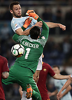 Calcio, Serie A: S.S. Lazio - A.S. Roma, stadio Olimpico, Roma, 15 aprile 2018. <br /> Lazio's Stefan De Vrij (up) in action with Roma's goalkeeper Alisson Becker (bottom) during the Italian Serie A football match between S.S. Lazio and A.S. Roma at Rome's Olympic stadium, Rome on April 15, 2018.<br /> UPDATE IMAGES PRESS/Isabella Bonotto