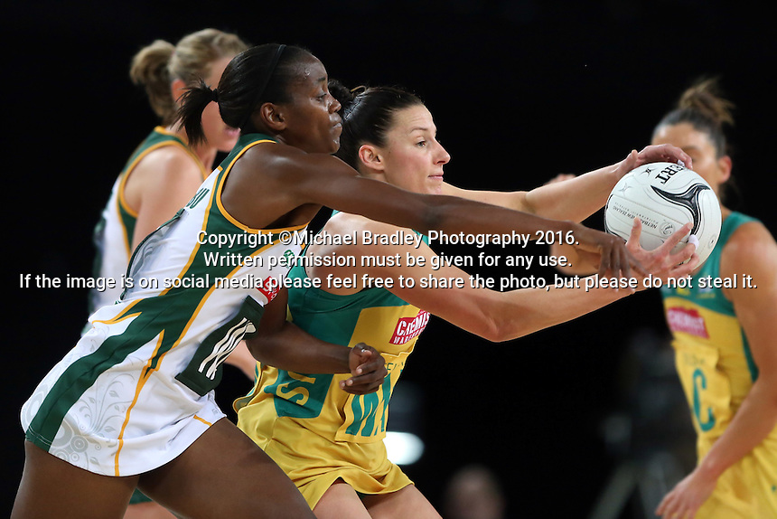 27.08.2016 South Africa's Precious Mthembu and Australia's Madi Robinson in action during the Netball Quad Series match between South Africa and Australia at Vector Arena in Auckland. Mandatory Photo Credit ©Michael Bradley.