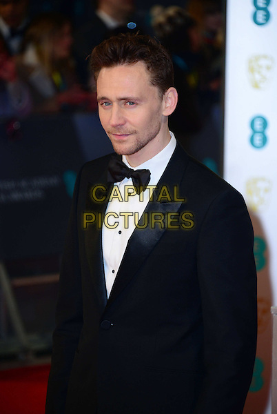LONDON, ENGLAND - FEBRUARY 08: Tom Hiddleston attends the EE British Academy Film Awards at The Royal Opera House on February 8, 2015 in London, England. <br /> CAP/JOR<br /> &copy;JOR/Capital Pictures