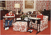 United States President Ronald Reagan and First Lady Nancy Reagan eat on TV trays in the White House residence on November 6, 1981.<br /> Credit: White House via CNP