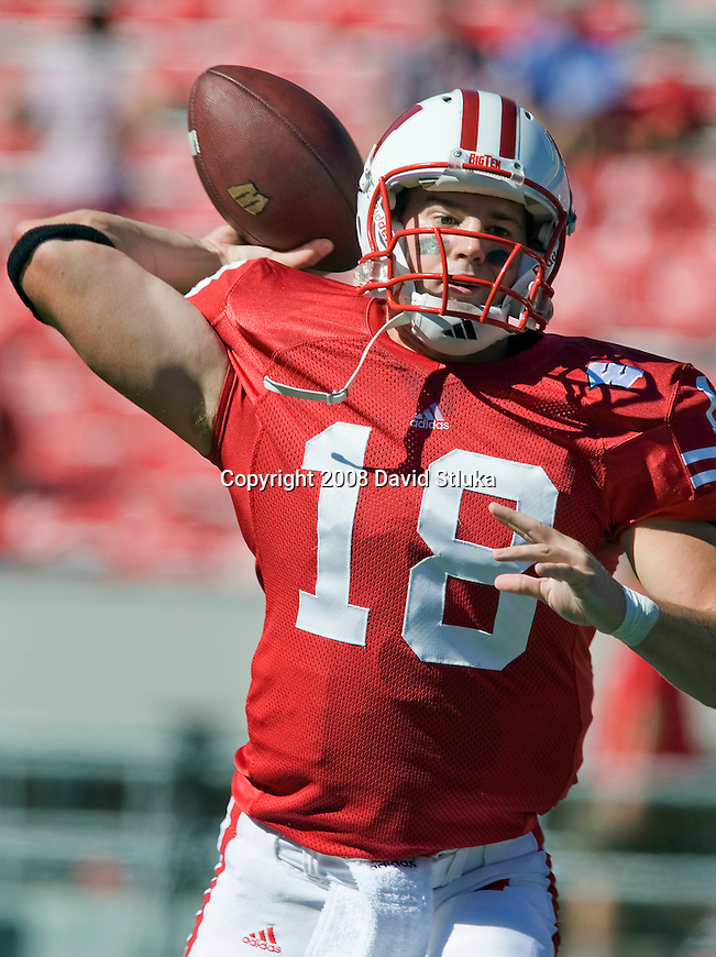 MADISON, WI - AUGUST 30: Quarterback Dustin Sherer #18 of the Wisconsin Badgers throws a pass during warmups prior to the game against the Akron Zips at Camp Randall Stadium on August 30, 2008 in Madison, Wisconsin. The Badgers beat the Zips 38-17. (Photo by David Stluka)