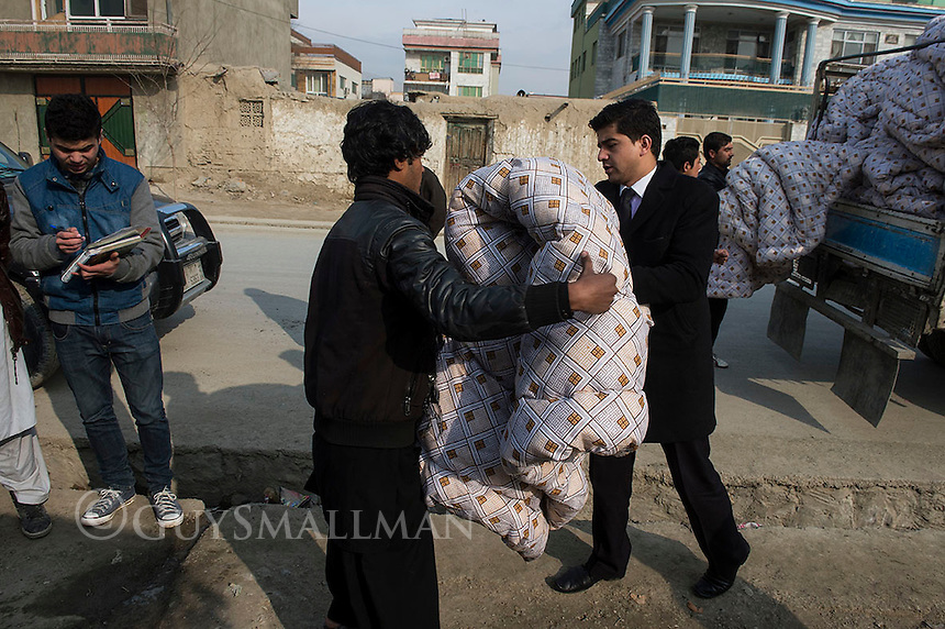 Afghan Action deliver quilts to a refugee camp in District 5 of Kabul. 21-1-14