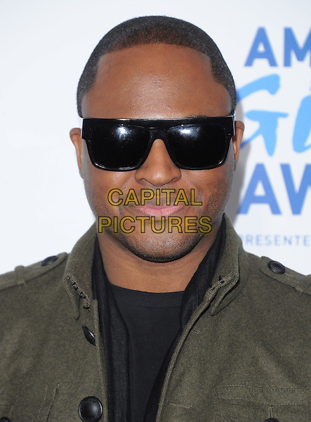 Taio Cruz .attends The  American Giving Awards held at Dorothy Chandler Pavilion in Los Angeles, California, USA, .December 9th 2011..portrait headshot black shades sunglasses green khaki jacket                    .CAP/RKE/DVS.©DVS/RockinExposures/Capital Pictures.