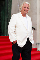David Emanuel arrives for the gala dinner at the Guildhall in Swansea