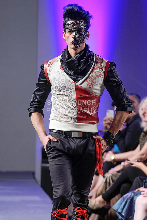 """Model walks runway in an outfit from the Giovanni Lo Presti """"Neo-Venezia"""" collection, during Couture Fashion Week in New York City, September 15, 2012."""