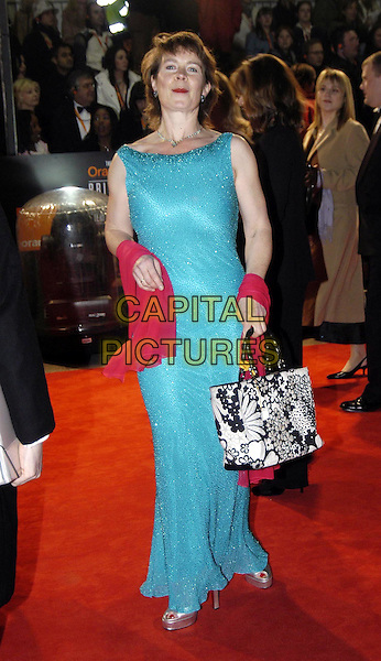 CELIA IMRIE.Bafta Awards - British Academy Awards at Odeon Leicester Square.15 February 2004.turquoise dress, pink wrap, shawl, full length, full-length, black and white handbag, floral print.www.capitalpictures.com.sales@capitalpictures.com.©Capital Pictures