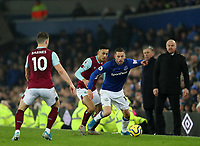 26th December 2019; Goodison Park, Liverpool, Merseyside, England; English Premier League Football, Everton versus Burnley; Gylfi Sigurdsson of Everton wins the ball as Dwight McNeil of Burnley and Ashley Barnes of Burnley challenge - Strictly Editorial Use Only. No use with unauthorized audio, video, data, fixture lists, club/league logos or 'live' services. Online in-match use limited to 120 images, no video emulation. No use in betting, games or single club/league/player publications