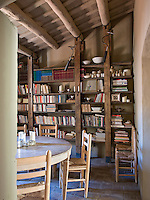 The dining room also doubles as a library with floor-to-ceiling bespoke book shelves