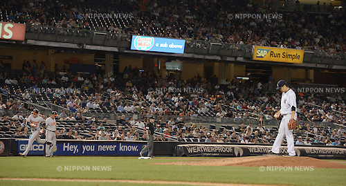 Masahiro Tanaka (Yankees),<br /> SEPTEMBER 8, 2015 - MLB :<br /> Masahiro Tanaka of the New York Yankees reacts after giving up a home run to Ryan Flaherty of the Baltimore Orioles who rounds the bases in the sixth inning during the Major League Baseball game at Yankee Stadium in the Bronx, New York, United States. (Photo by AFLO)