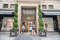 Shoppers outside of the Saks Fifth Avenue flagship store in New York on Thursday, June 11, 2015. Hudson's Bay, the Canadian owner of Saks and Lord & Taylor, reported a first-quarter loss of CA $54 million citing administrative expenses and costs related to sales. The Saks division rose 0.6 % while its outlet brand OFF 5th  rose 10.3 %. (© Richard B. Levine)