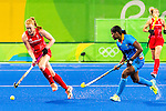 Sunita Lakra #26 of India defends during India vs Great Britain in a Pool B game at the Rio 2016 Olympics at the Olympic Hockey Centre in Rio de Janeiro, Brazil.