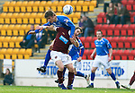 St Johnstone v Hearts....24.03.12   SPL.Murray Davidson and Scott Robinson.Picture by Graeme Hart..Copyright Perthshire Picture Agency.Tel: 01738 623350  Mobile: 07990 594431