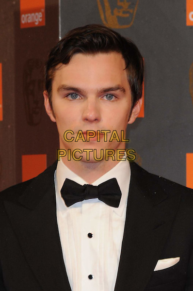 NICHOLAS HOULT .2011 Orange British Academy Film Awards (Baftas) at The Royal Opera House, London, England, UK,.February 13th, 2011..arrivals portrait headshot black tuxedo tux bow tie .CAP/WIZ.© Wizard/Capital Pictures.