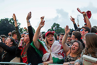 Wales fans celebrate their side's second goal at the Cardiff Fanzone during the Euro 2016 quarter final between Wales and Belgium , Cardiff, Wales on 1 July 2016. Photo by Mark  Hawkins/PRiME Media Images.