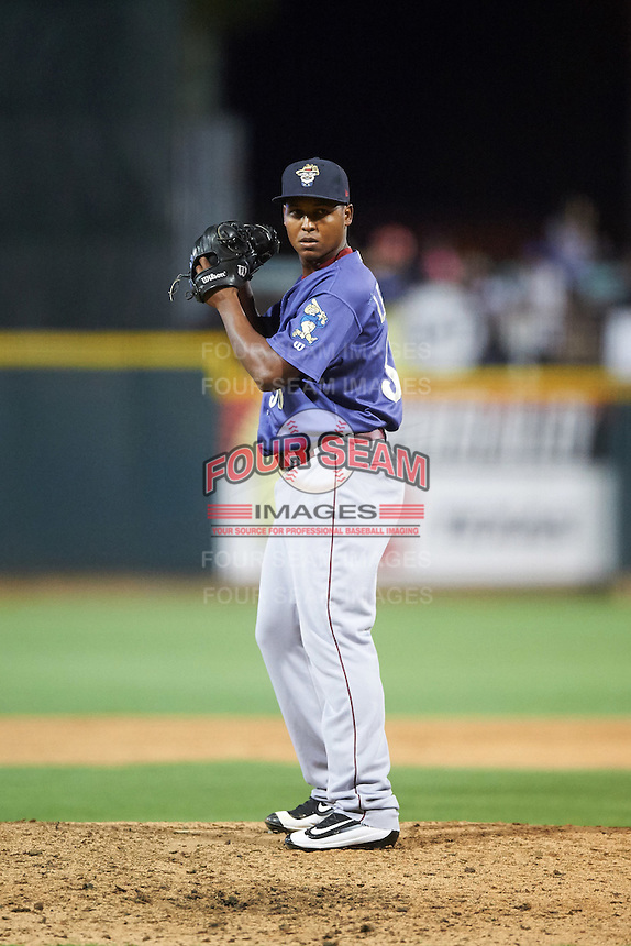 Frisco RoughRiders relief pitcher Jose Leclerc (30) gets ready to deliver a pitch during a game against the Corpus Christi Hooks on April 23, 2016 at Whataburger Field in Corpus Christi, Texas.  Corpus Christi defeated Frisco 3-2.  (Mike Janes/Four Seam Images)
