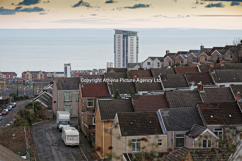 General view of house in the Mountain Pleasant area and the Meridian Quay in Swansea, Wales, UK. Wednesday 30 January 2019