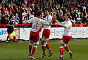 Scott Laird of Stevenage Borough celebrates with Tim Sills and David Bridges (r) after scoring from the penalty spot for their second goal during the Blue Square Premier match between Stevenage Borough and Forest Green Rovers at the Lamex Stadium, Broadhall Way, Stevenage on Saturday 10th April, 2010 ..© Kevin Coleman 2010