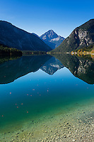 Mountain reflection on Plansee, Tyrol, Austria