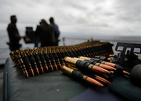 070628-N-7981E-027 Pacific Ocean (June 28, 2007)- Sailors from weapons department fire a .50 caliber machine gun during a familiarization fire exercise on the fantail of the Nimitz-class aircraft carrier USS Abraham Lincoln (CVN 72). Lincoln is conducting sea trials following a nine-month Dry-dock Planned Incremental Availability (DPIA) at Puget Sound Naval Shipyard in Bremerton, Wash.  Sea trials will test Lincoln's systems and crew in preparation for their return to full operational capability status. U.S. Navy photo by Mass Communications Specialist 3rd Class James R. Evans (RELEASED)