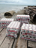 INDONESIA, Mentawai Islands, cases of Bintang beer on a boat dock, Sipora Island