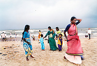 Tourists returning to Vellengani beach, one of the most effected areas in Tamil Nadu.India.
