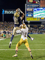 Pitt wide receiver Devin Street (15) makes a 3-yard touchdown reception as Notre Dame defensive back Bennett Jackson watches. The Pittsburgh Panthers defeated the Notre Dame Fighting Irish 28-21 at Heinz Field, Pittsburgh, Pennsylvania on November 9, 2013.