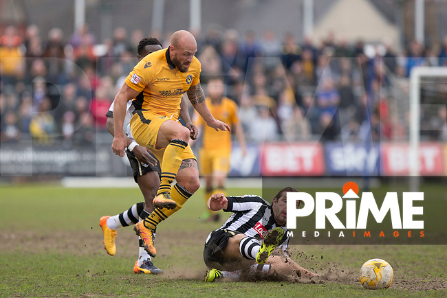 David Pipe of Newport County is tackled by Alan Smith of Notts County during the Sky Bet League 2 match between Newport County and Notts County at Rodney Parade, Newport, Wales on 6 May 2017. Photo by Mark  Hawkins / PRiME Media Images.