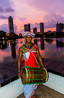 Musicains outside Seema Malaka Temple at twilight, Beira Lake, Colombo, Sri Lanka.