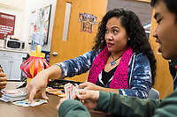Karonika Brown, 34, (center) plays UNO before a Lunar New Year celebration in the Asian American Connections Center at Middlesex Community College in Lowell, Mass., USA, on Thurs., Feb. 15, 2018. Brown graduated with a degree with an Associates Degree in Liberal Arts and Sciences from Middlesex Community College in 2016, and continues to take classes there and work as a writing tutor for other students. Brown is an immigrant from Cambodia. The Asian American Connections Center was established at the school using a federal grant in 2016 and serves as a focal point for the Asian community at the school, predominantly Cambodian, to gather, socialize, study, and otherwise take part in student life.