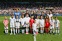 Angel Rangel of Swansea City (R), Ryan Shawcross of Stoke City (L), referee Anthony Taylor (C) his assistants and children mascots before kick off during the Premier League match between Swansea City and Stoke City at The Liberty Stadium, Swansea, Wales, UK. Sunday 13 May 2018
