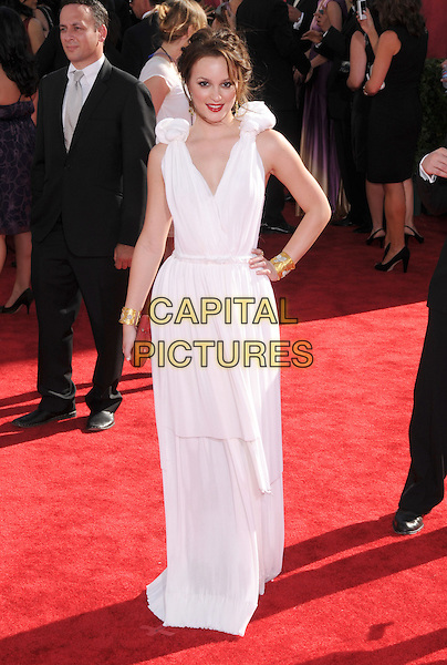 LEIGHTON MEESTER.Arrivals at the 61st Primetime Emmy Awards held at Te Nokia Theater in Los Angeles, California, USA..September 20st, 2009     .emmys full length sleeveless dress white  red clutch bag gold bracelets hand on hip.CAP/DVS.©Debbie VanStory/Capital Pictures.