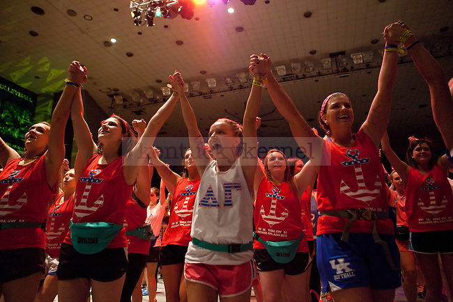 From left to right Jessie Dalton, Emily Bell and Arden Gross of Alpha Gamma Delta dance the hourly line dance at Dance Blue in Memorial Coliseum in Lexington, Ky., on Saturday, February 22, 2014. Photo by Emily Wuetcher | Staff