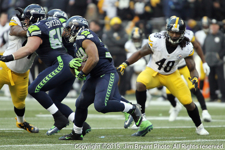 Seattle Seahawks running back Thomas Rawls (34) rushes against the Pittsburgh Steelers at CenturyLink Field in Seattle, Washington on November 29, 2015.  The Seahawks beat the Steelers 39-30.      ©2015. Jim Bryant Photo. All Rights Reserved.