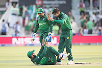 Mohammad Amir (Pakistan) and Safaraz Ahmed (Pakistan) look on as Shadab Khan (Pakistan) has flattened the wicket attempting a run out during Pakistan vs Bangladesh, ICC World Cup Cricket at Lord's Cricket Ground on 5th July 2019