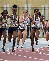 NWA Democrat-Gazette/BEN GOFF @NWABENGOFF<br /> Tiana Wilson (right) of Arkansas hands off to Payton Chadwick for the second leg as Gabrielle Gibson of Oral Roberts hands off to teammate Kayvon Stubbs in the women's 4x100 meter relay Friday, April 12, 2019, at the John McDonnell Invitational at John McDonnell field in Fayetteville. The Arkansas team won the event with a time of 44.28 seconds.