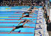 July 30, 2012: Lto R: Sike Lippok GER, Samantha Cheverton CAN, Melanie Costa Schmid ESP, Federica Pellegrini ITA, Missy Franklin USA, Caitlin McClatchey GBR, Kyle Palmer AUS and Hanae Ito of JPN dive off the starting block to compete in women's 200m freestyle semifinal at the Aquatics Center on day three of 2012 Olympic Games in London, United Kingdom.