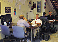 Certified flight instructors Tom Duizendorf and Mark Norquist work with students in the Aeroventure offices, Petaluma Municipal Airport, Petaluma, Sonoma County, California