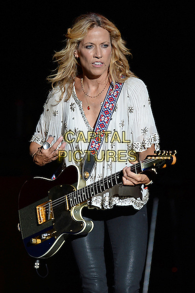 WEST PALM BEACH - SEPTEMBER 13: Sheryl Crow performs at the Cruzan Amphitheatre on September 13, 2014 in West Palm Beach, Florida. <br /> CAP/MPI/mpi04<br /> &copy;mpi04/MediaPunch/Capital Pictures