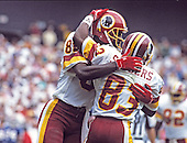 Washington Redskins wide receivers Art Monk (81) and Rickey Sanders (83) celebrate after Sanders scored a touchdown during the game against the New York Giants at RFK Stadium in Washington, D.C. on October 2, 1988.  The Redskins lost the game 24 - 23.<br /> Credit: Arnie Sachs / CNP