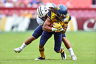 Landover, MD - SEPT 24, 2016: West Virginia Mountaineers wide receiver Ka'Raun White (2) catches a pass for a first down during their match up against BYU at FedEx Field in Landover, MD. (Photo by Phil Peters/Media Images International)