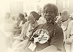 "MAY 9, 2011 - MINEOLA, NY: Mr. Joe Lewis Brown, wearing big ""We Deserve Better"" button, at Redistricting hearing at Nassau County Executive and Legislative Building at 1550 Franklin Avenue, Mineola, New York, USA on May 9, 2011"