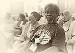 "MAY 9, 2011 - MINEOLA, NY: Mr. Joe Lewis Brown, wearing big ""We Deserve Better"" button, at Redistricting hearing at Nassau County Executive and Legislative Building at 1550 Franklin Avenue, Mineola, New York, USA on May 9, 2011"