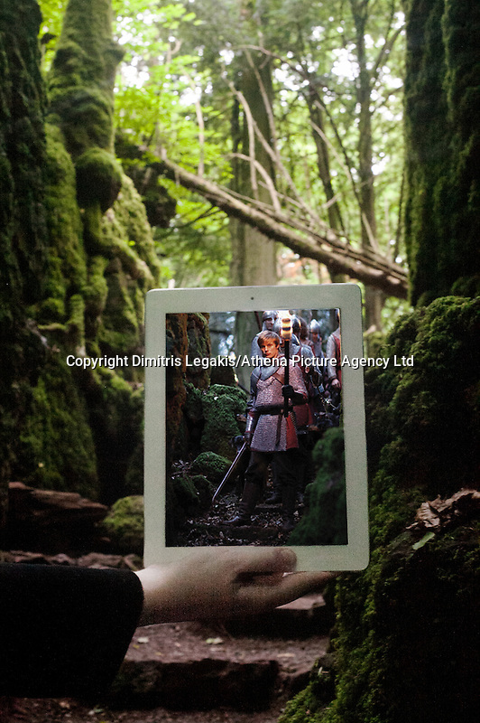 """Pictured: Filming of Merlin at Puzzle Wood in Gloucester<br /> Re: A pair of film lovers have turned detective to track down locations from films and TV shows - and capture the exact scenes on their iPads.<br /> Tiia Ohman, 25, and Satu Walden, 26, travel hundreds of miles across Britain tracing the footsteps of their movie heroes to photograph the action spots.<br /> The two young women who live in Cardiff painstakingly recreate their favourite scenes using an iPad or phone screens to stand in for the stars.<br /> They've brought to life scenes from silver screen blockbuster such as Harry Potter, Les Miserables and Warhorse.<br /> And their """"sceneframing"""" shots also feature locations seen in Dr Who, Sherlock and Merlin.<br /> Tiia said: """"This combines our love of TV and movies, photography, travel and much more.<br /> """"What started as an epic road trip to filming locations all over the UK eventually led to a series of photos we like to call sceneframing.<br /> """"Visiting filming locations is the perfect way to see places you wouldn't necessarily find in Lonely Planet books and travel guides.""""<br /> Tiia and Satu, originally from Finland, live in Cardiff where they spend their spare time researching film locations.<br /> Their """"fangirl quest"""" blog (www.fangirlquest.com) has already seen them cover more than 2,000 miles travelling across the country including top locations in Cardiff, Newport and Pembrokeshire."""