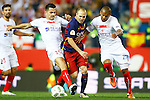 FC Barcelona's Andres Iniesta (c) and Sevilla CF's Vitolo (l) and Mariano Ferreira during Spanish Kings Cup Final match. May 22,2016. (ALTERPHOTOS/Acero)